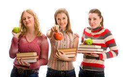 Estudantes consideravelmente novos. Isolado no branco. Foto de Stock Royalty Free