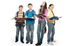 Estudantes da leitura Fotos de Stock