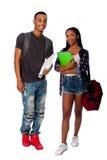 Estudantes de sorriso felizes que estão junto Imagem de Stock
