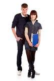 Estudantes dos pares sobre um fundo branco Foto de Stock Royalty Free