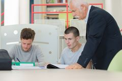 Estudantes e seu professor Imagem de Stock Royalty Free