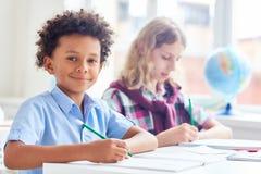 Estudantes na lição imagens de stock