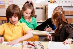 Estudantes no trabalho Foto de Stock Royalty Free