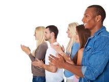 Estudantes que aplaudem as mãos Fotografia de Stock