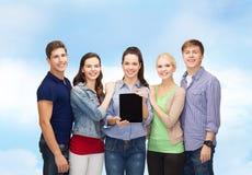 Estudantes que mostram a tela vazia do PC da tabuleta Imagem de Stock Royalty Free