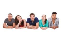 Estudantes universitário que encontram-se sobre o fundo branco foto de stock royalty free
