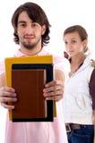 Estudantes universitários novos com livros Imagem de Stock