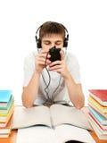 Estudiante aburrido en auriculares Imagen de archivo libre de regalías