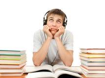 Estudiante aburrido en auriculares Imágenes de archivo libres de regalías