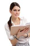 Estudiante adolescente alegre con el libro aislado en blanco Foto de archivo
