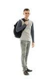 Estudiante adolescente con la mochila en blanco Fotografía de archivo
