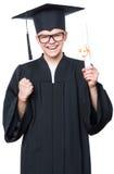Estudiante adolescente graduado del muchacho Imagen de archivo libre de regalías