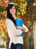 Estudiante adolescente lindo en fondo del otoño Imagenes de archivo