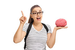 Estudiante adolescente que celebra un modelo y gesticular del cerebro Foto de archivo libre de regalías