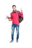 Estudiante adolescente que sostiene el bolso y los libros Foto de archivo libre de regalías