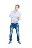 Estudiante adolescente que sostiene una tableta aislada en blanco Imagen de archivo libre de regalías