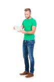 Estudiante adolescente que sostiene una tableta en blanco Fotografía de archivo