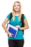 Estudiante adolescente sonriente de la muchacha con los libros Foto de archivo libre de regalías