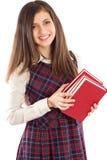 Estudiante adorable que sostiene una pila de libros Imágenes de archivo libres de regalías