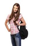 Estudiante agradable con el bolso de escuela Imágenes de archivo libres de regalías