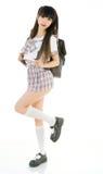 Estudiante asiática atractiva en uniforme escolar Fotos de archivo