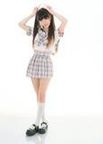Estudiante asiática atractiva en uniforme escolar Foto de archivo libre de regalías