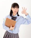 Estudiante asiática en uniforme escolar Fotografía de archivo libre de regalías