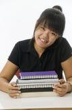 Estudiante asiático con los cuadernos Fotografía de archivo