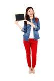 Estudiante asiático con un tablero de la muestra Fotografía de archivo