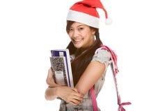 Estudiante asiático en el sombrero y el cuaderno de Santa de la Navidad Imagen de archivo libre de regalías