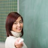 Estudiante asiático joven sonriente hermoso Foto de archivo