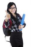 Estudiante asiático que muestra el pulgar-para arriba Fotografía de archivo