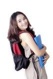 Estudiante bastante adolescente con la mochila Imagen de archivo