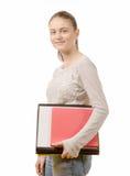 Estudiante bastante adolescente feliz con ella estudios en el fondo blanco Imagen de archivo libre de regalías