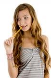 Estudiante bonito del adolescente con el lápiz Foto de archivo libre de regalías