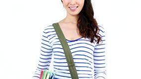 Estudiante bonito que sonríe en la cámara almacen de video