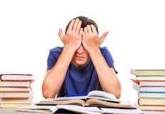 Estudiante cansado con libros Imagenes de archivo