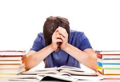 Estudiante cansado con libros Fotos de archivo libres de regalías