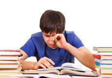 Estudiante cansado con libros Imagen de archivo