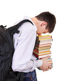 Estudiante cansado con los libros Foto de archivo libre de regalías