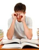 Estudiante cansado con los libros Fotos de archivo libres de regalías