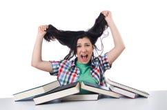 Estudiante cansado con los libros de texto Foto de archivo