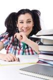 Estudiante cansado con los libros de texto Fotografía de archivo