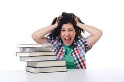 Estudiante cansado con los libros de texto Imagen de archivo