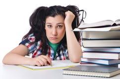 Estudiante cansado con los libros de texto Imágenes de archivo libres de regalías