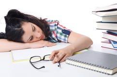 Estudiante cansado con los libros de textos Fotografía de archivo