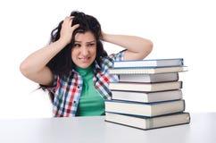 Estudiante cansado con los libros de textos Foto de archivo libre de regalías
