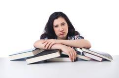 Estudiante cansado con los libros de textos Imagen de archivo