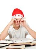 Estudiante cansado en Santa Hat Imagenes de archivo