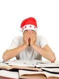 Estudiante cansado en Santa Hat Imagen de archivo libre de regalías
